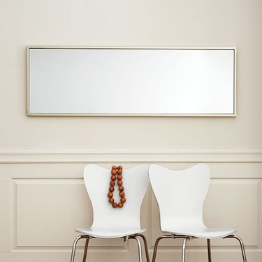A horizontal wardrobe mirror used as an entryway mirror.