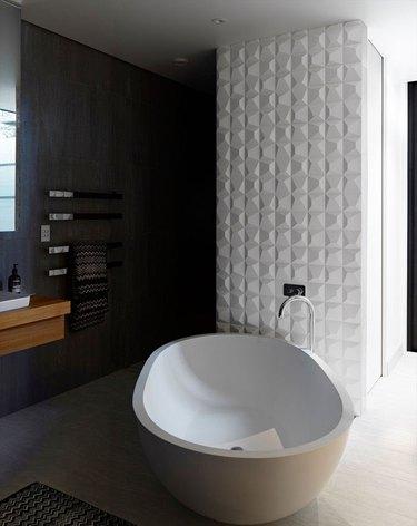 textured tile on wall in bathroom