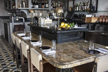 The marble martini bar and brass lamps