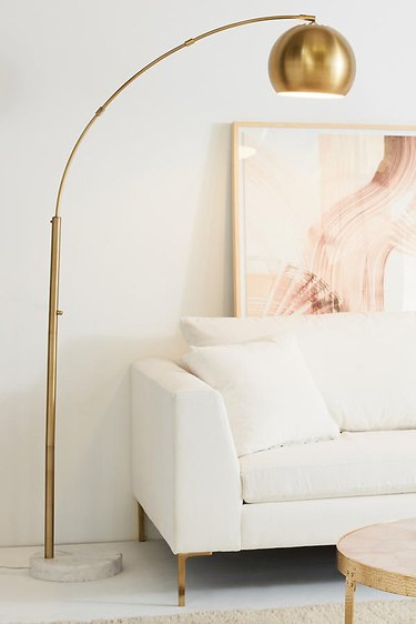 brushed brass arco lamp anthropology midcentury modern style living room