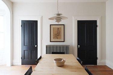 black doors in dining room