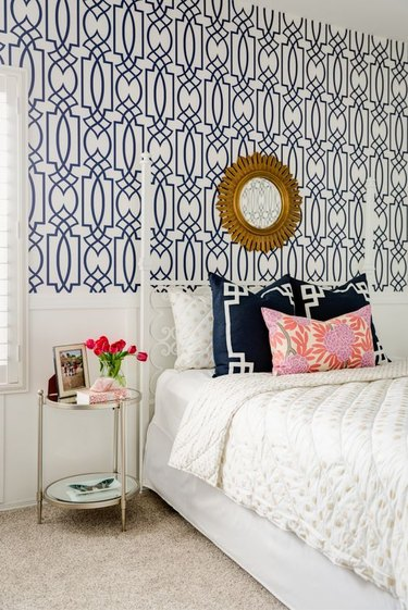 Bedroom with blue geometric wallpaper