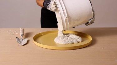 Pouring concrete into GLADOM tray for terrazzo tabletop