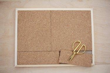 Cutting cork tiles to fit bulletin board