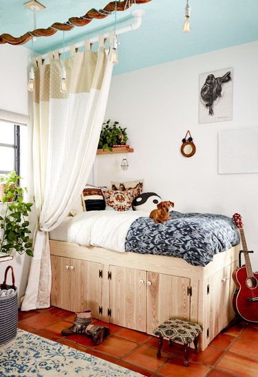 bedroom with turquoise ceiling
