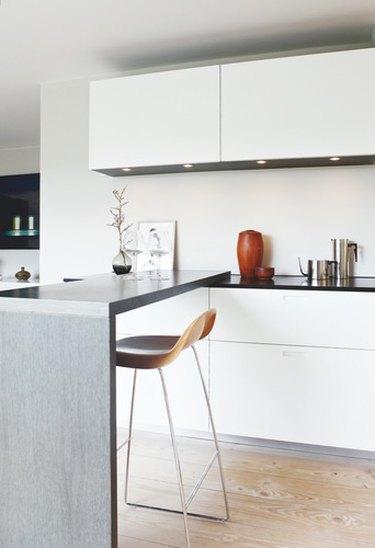 crate and barrel counter stool in minimalist Scandinavian kitchen