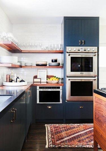farmhouse kitchen with open shelving and beadboard cabinets