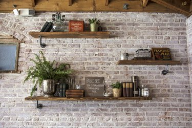 Exposed brick and handmade shelving