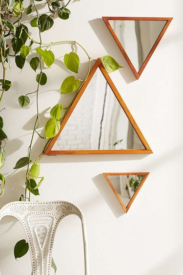 Urban Outfitters triangular mirrors.