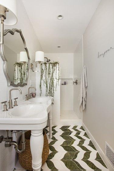 Photo of bathroom with half-wall walk-in shower.