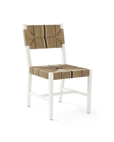 White dining chair with woven base and back