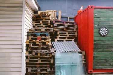 Pallets stacked for recycling.
