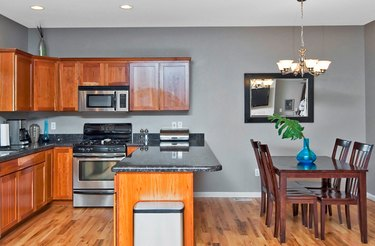 Wood floors and furnishings complement warmer gray tones.