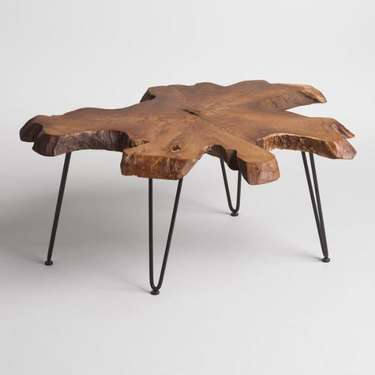 Raw-edge wooden coffee table with black metal legs
