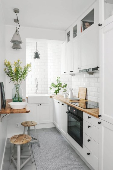 White kitchen with a folding countertop