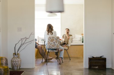 Three people sitting at the kitchen table