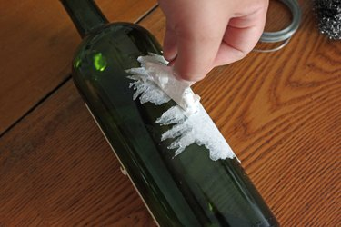 Peel off the label by hand.