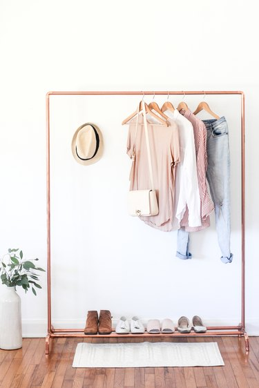 How to Organize Clothes with diy copper clothes stand in minimal bedroom