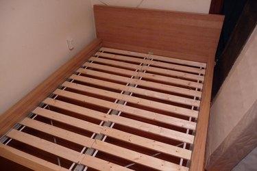 Wooden bed slats.