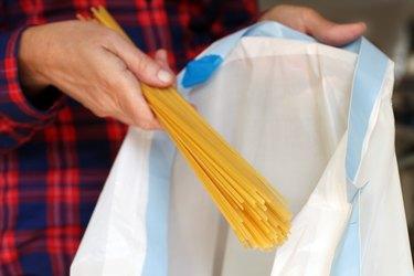 Disposing of pasta.