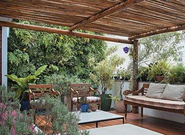 Deck with pergola, bench, chairs, plants