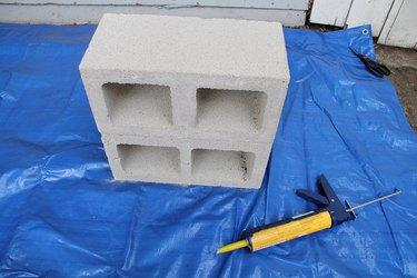 Glue together two cinder blocks.