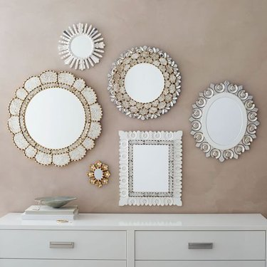 A series of Moroccan-stype mirrors in a collage by West Elm.