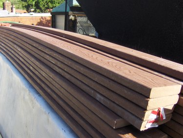 Stack of composite decking boards.