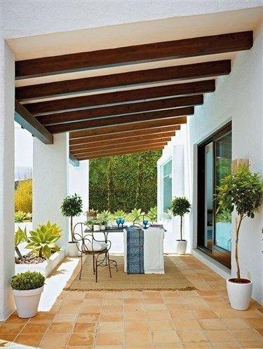 covered patio exposed beam spanish villa