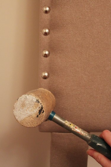 Use a rubber mallet to gently tap nailhead in place.