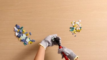 Cutting glass tiles and mosaic smalti for terrazzo table