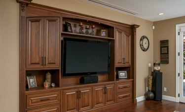 large flat screen tv in built-in entertainment center