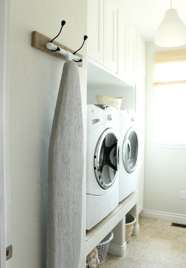 wall-mounted ironing board rack