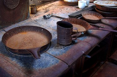 Old cast iron frying pans and stovetop.