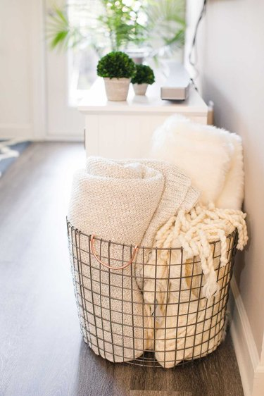 wire basket with blankets