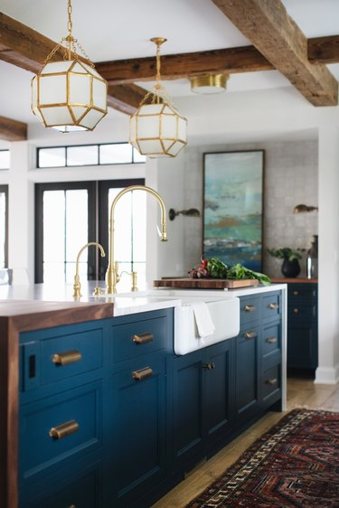 farmhouse kitchen with blue cabinets and apron sink