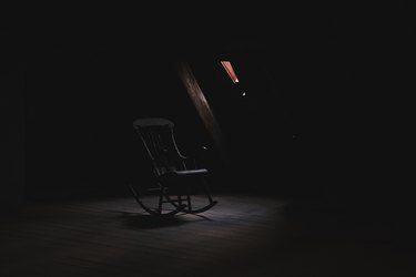 Rocking chair in a dark space.