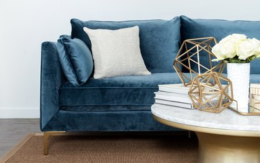 A turquoise-blue couch
