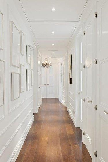 White hallway with molding