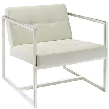 White upholstered armchair with silver metal frame and arms
