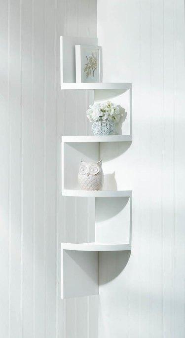 white alternating corner shelves