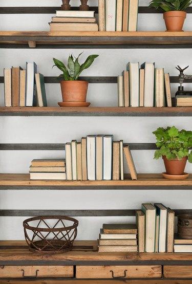 books turned backwards on bookcase
