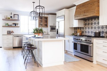 farmhouse L-shaped kitchen with white cabinets