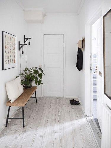 Hallway with white-washed floors