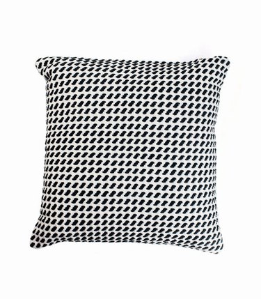 Oversized throw pillow with small black and white pattern