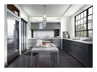 siematic classic kitchen with marble countertops and table
