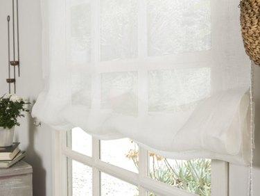 White sheer linen roman blinds