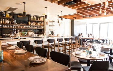 All-Day Eatery Suburbia Makes Black Leather and Shiny Copper Suitable for the Beach