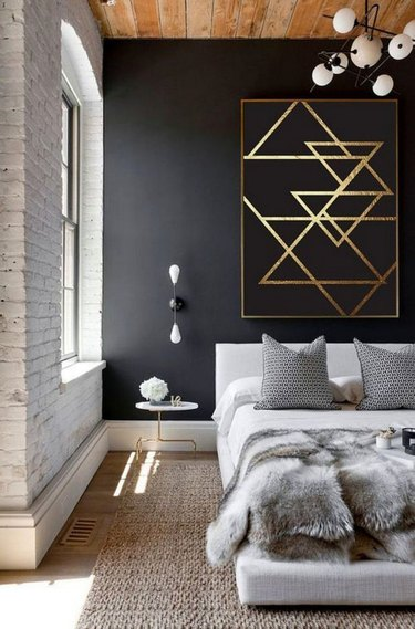 Bedroom with wooden ceiling and black wall
