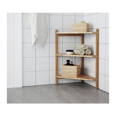 corner shelf by Ikea in bathroom.